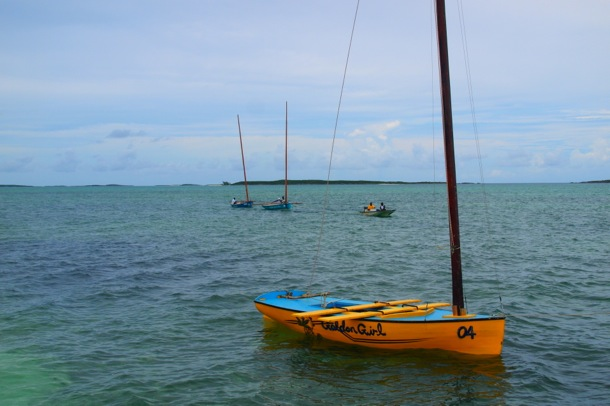 Golden Girl waits as two other sloops are tugged into position/SBPR