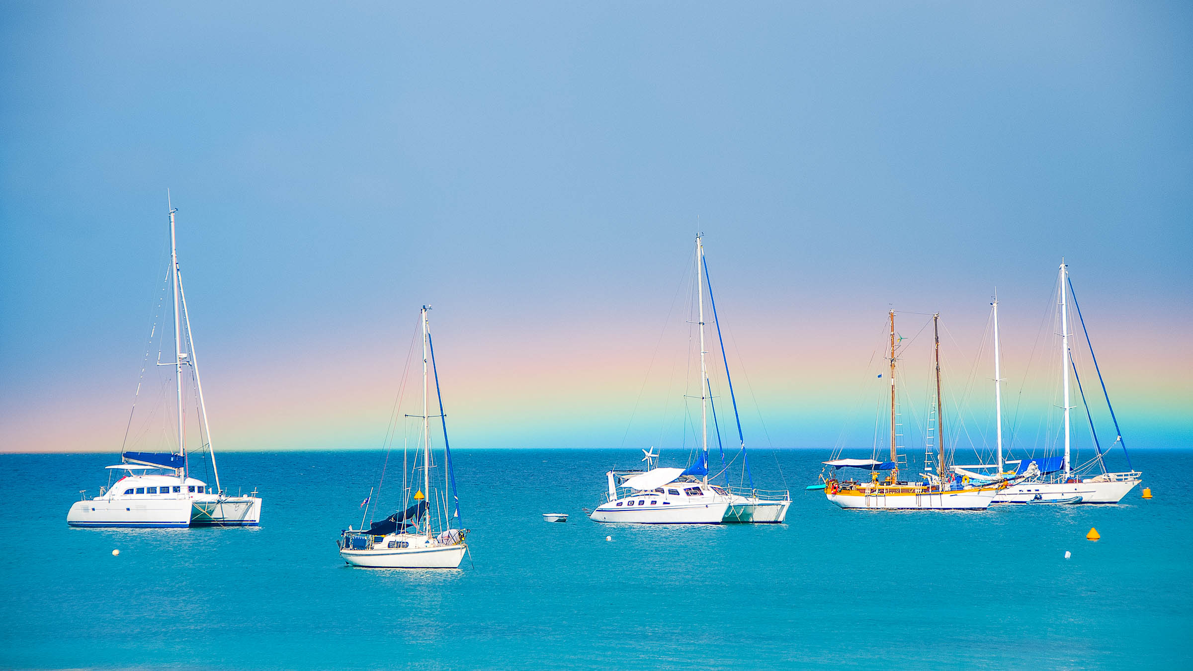Sailboats off Martinique by Patrick Bennett
