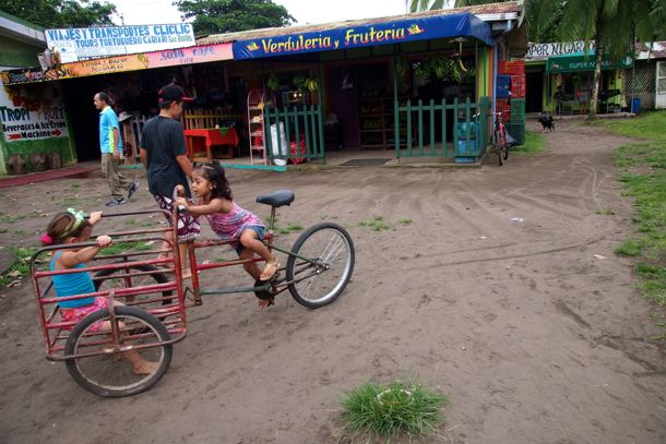 """Kids playing along the """"road"""" in Tortuguero"""