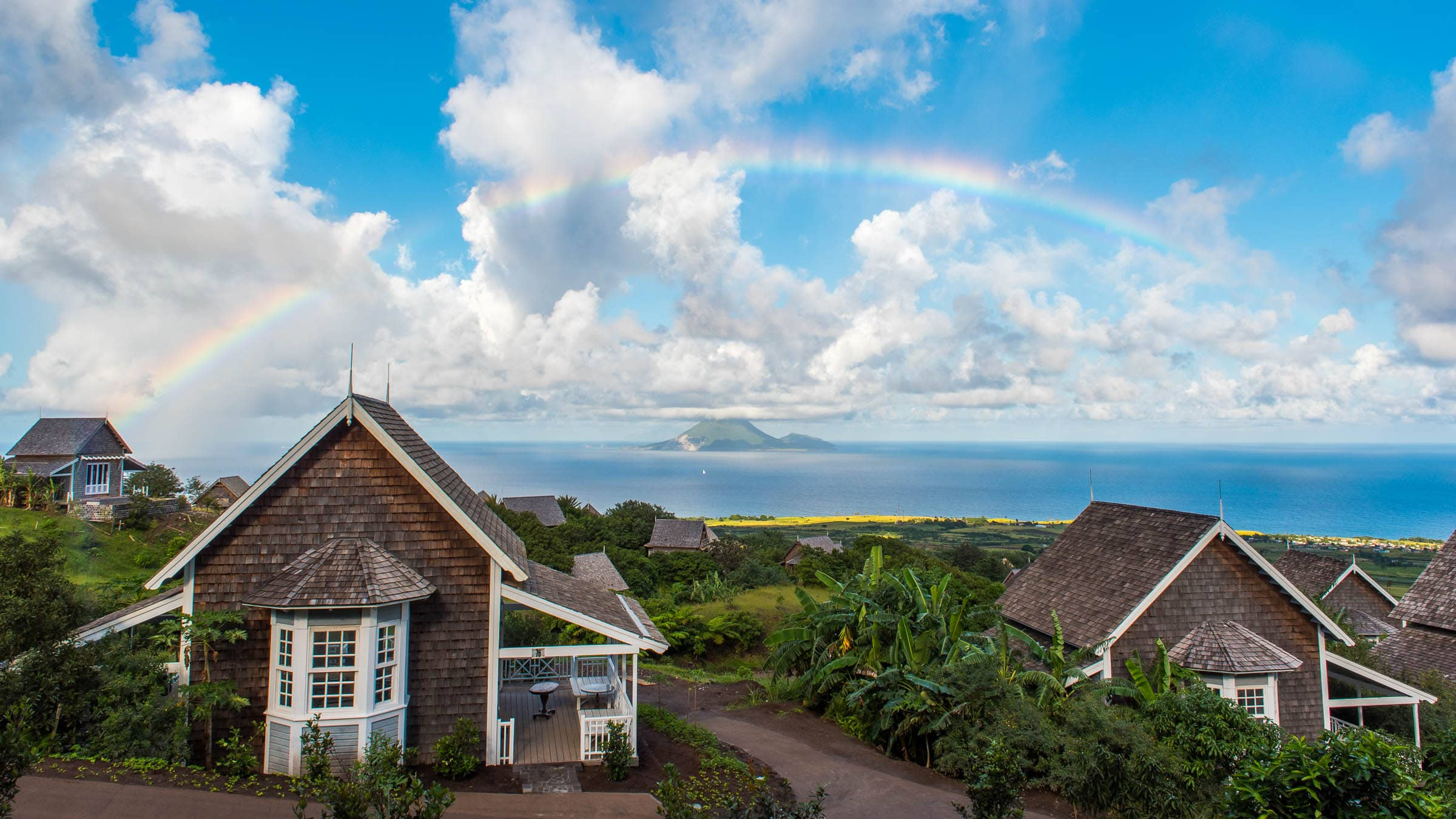 Rainbow over Belle Mont Farm on Kittitian Hill by Patrick Bennett