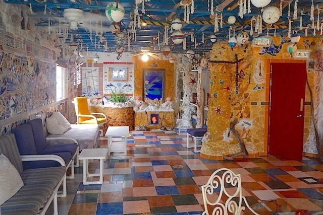 An explosion of color and kitsch inside Dolphin House, North Bimini | Credit: Zickie Allgrove