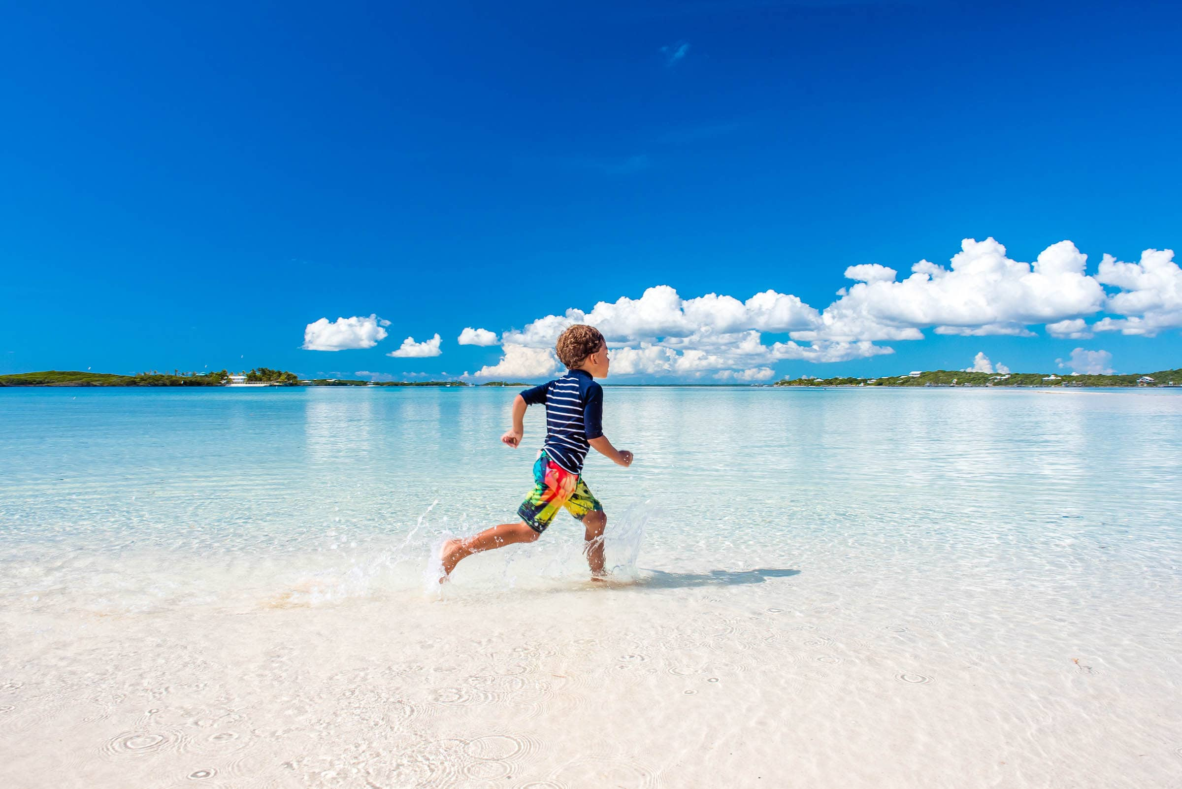 Running on Tahiti Beach, Elbow Cay, Abaco, The Bahamas by Patrick Bennett