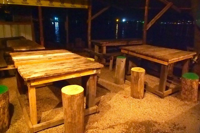 Rustic tables, stools at Monty's Fish Grill and Bar, Dominica | SBPR