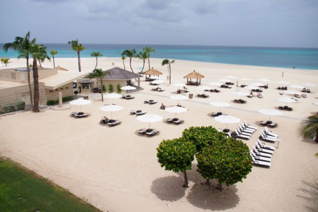 Bucuti and Tara Beach Resort's white umbrellas. Can you spot the one blue one..? | SBPR