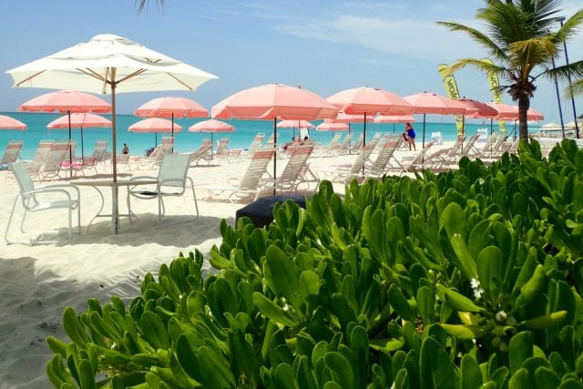 The iconic pink umbrellas at Ocean Club East, Turks and Caicos | SBPR