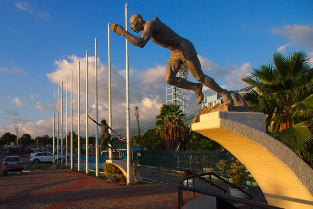 Statues of local sporting greats adorn the grounds outside the Jamaica National Stadium