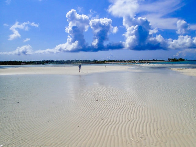 Chasing clouds across a sandbar in Bimini. The Bahamas