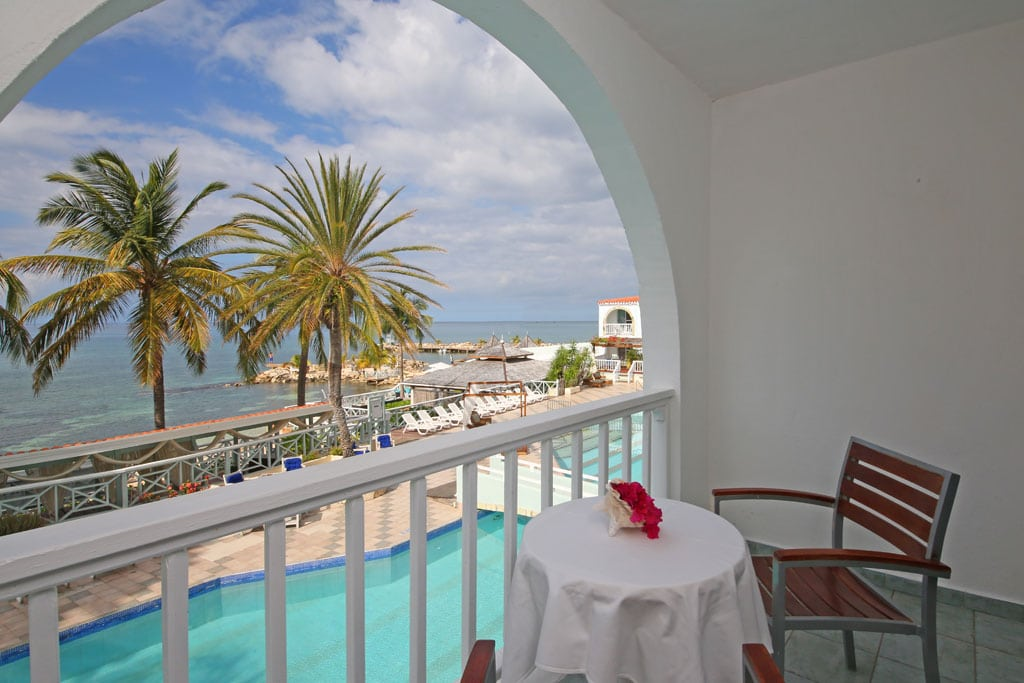 Balconies look out over the pools and beach areas. (Photo provided)