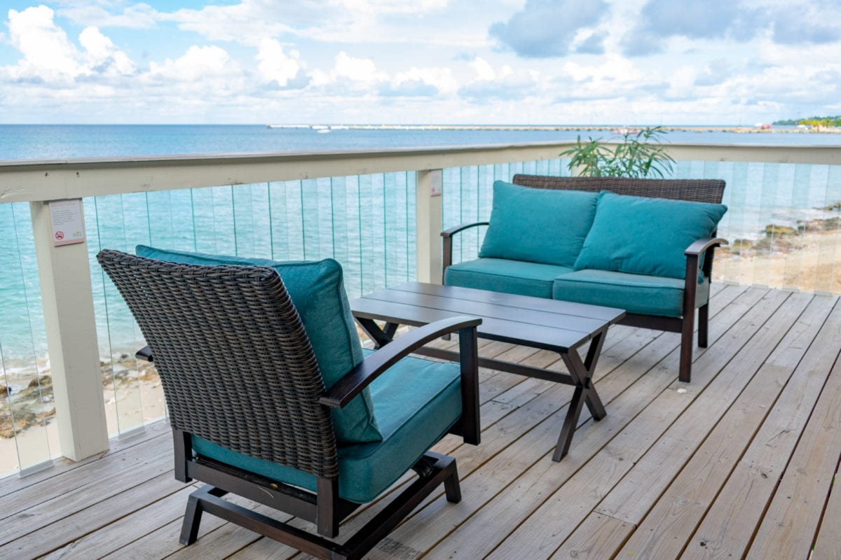 Comfy chairs and clear balusters allow for unobstructed views from Douglas House at The Fred, St. Croix | SBPR