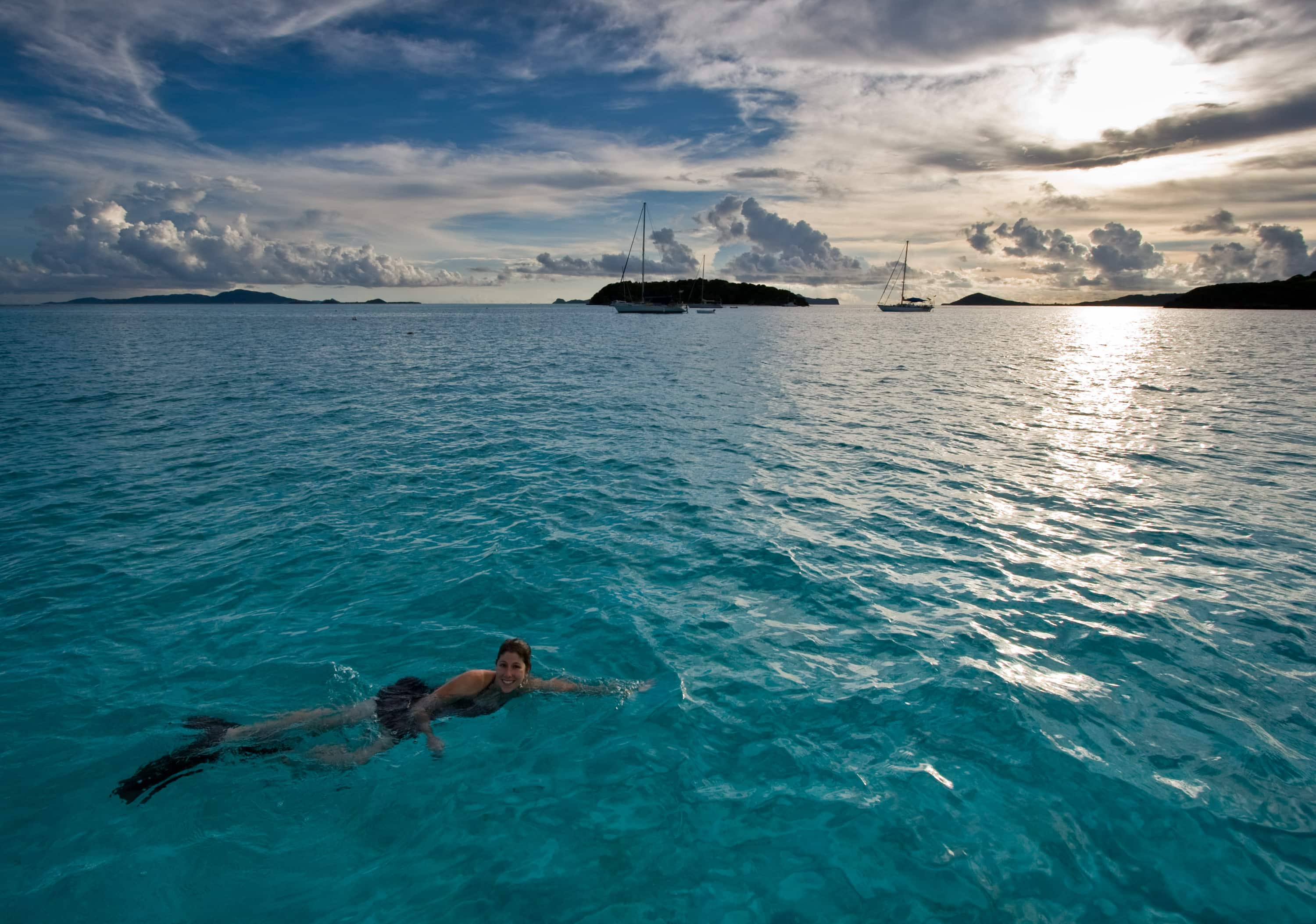 Sunset Swimming In The Grenadines | Credit: Flickr user Jason Pratt