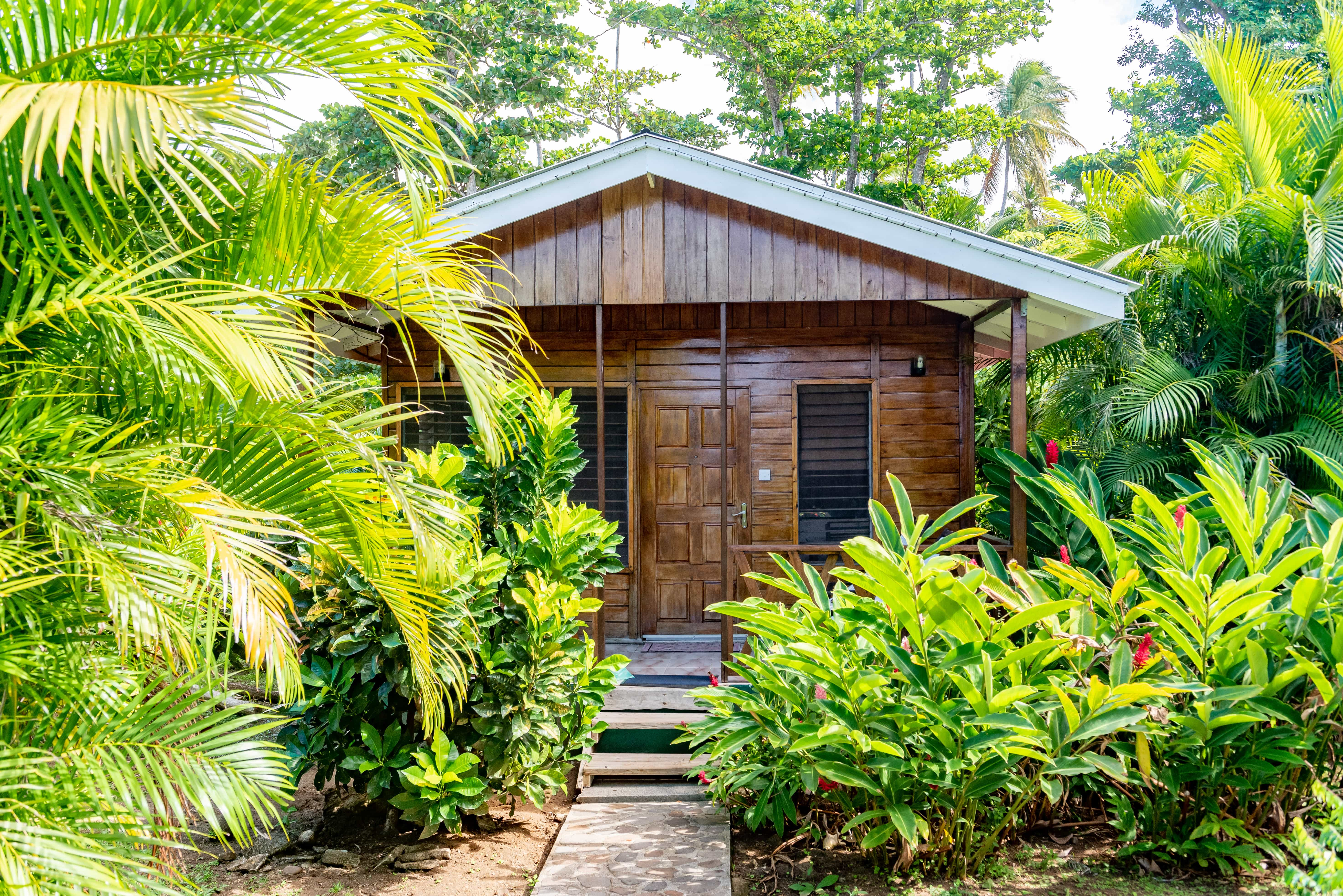 Picard Beach Cottages is just that; a collection of rustic wooden cottages right on the black sands of Portsmouth Beach.