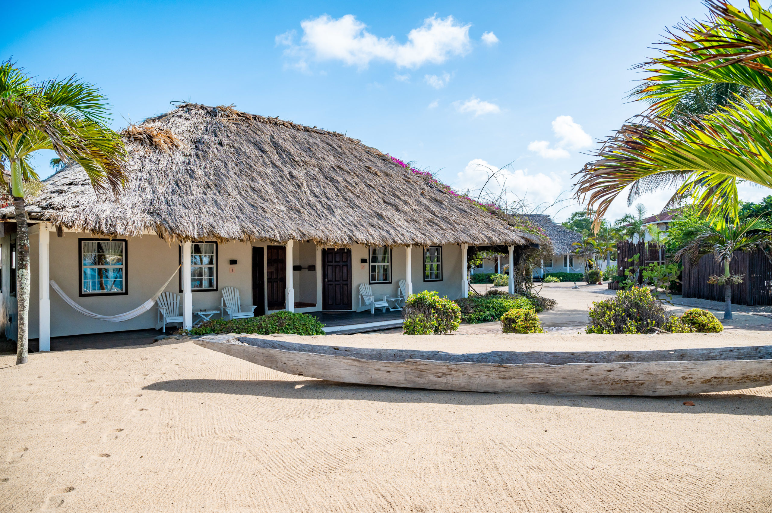 The sandy beachfront grounds keep the Belizean shore top of mind.